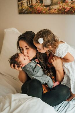 Lots of love for mom during postpartum - Photo by Vincent Delegge on Unsplash
